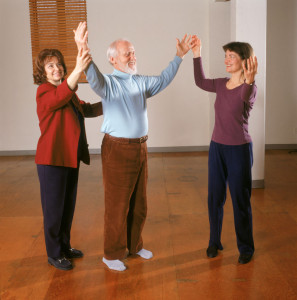 Diane Harlowe, Jim Kerr and Tricia do the ROM Dance®