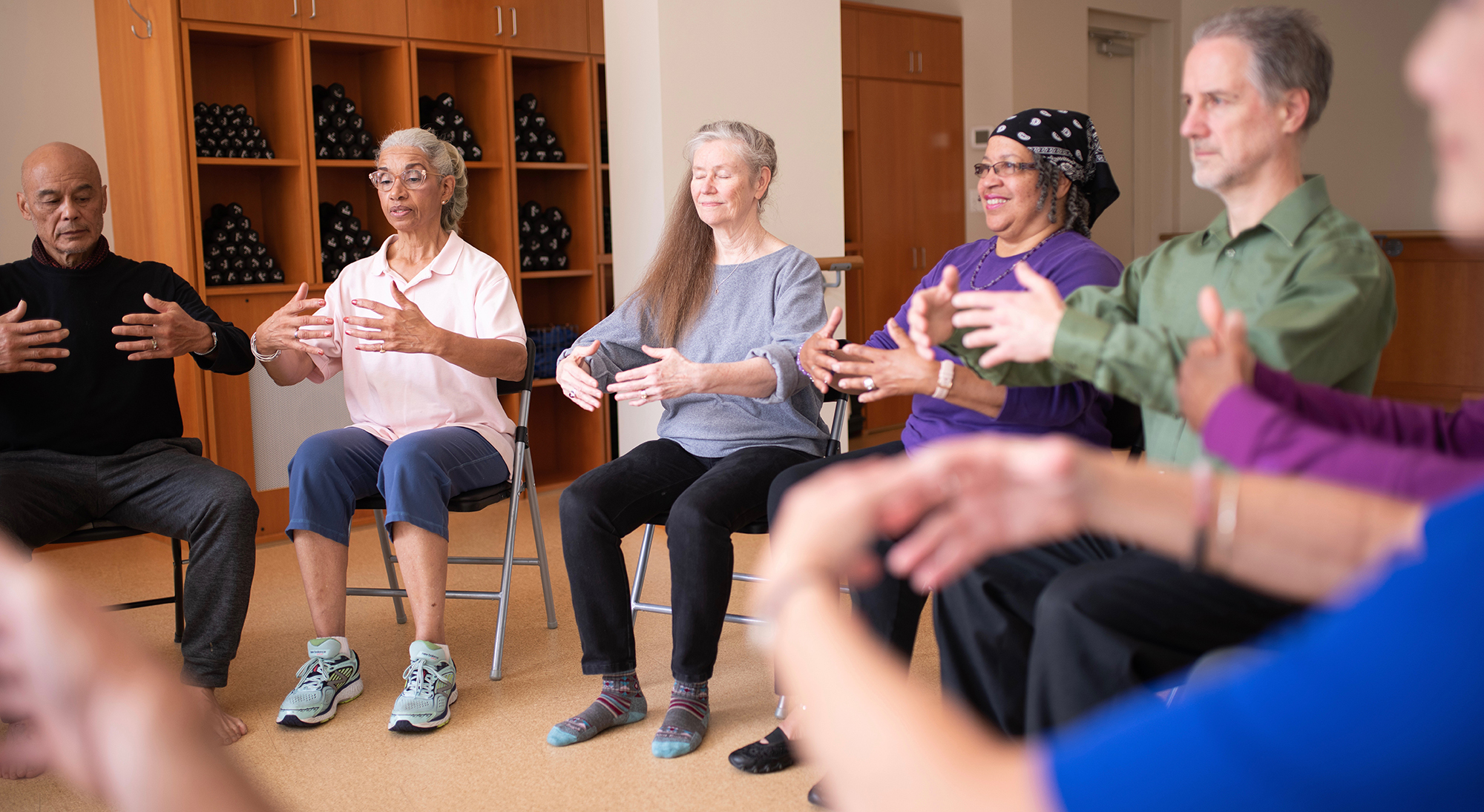 Seated Activities:  Class practices qi gong posture, Holding the Moon.