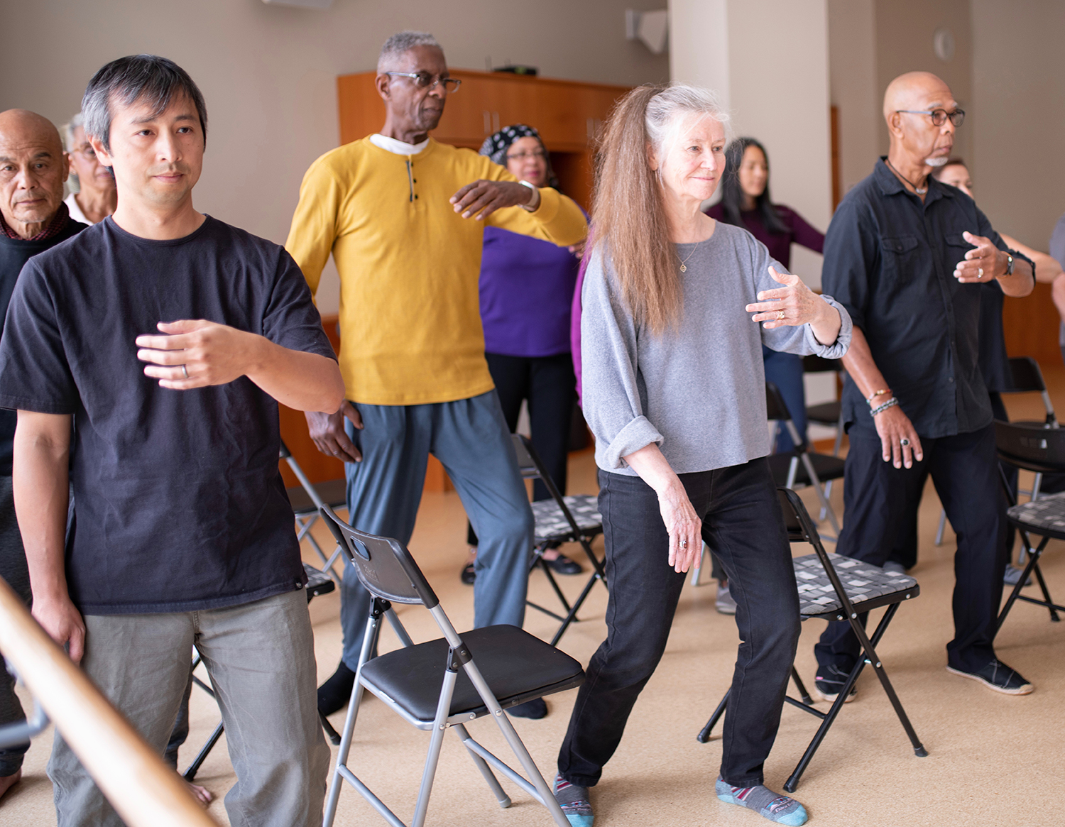 Participants practice Ward Off move